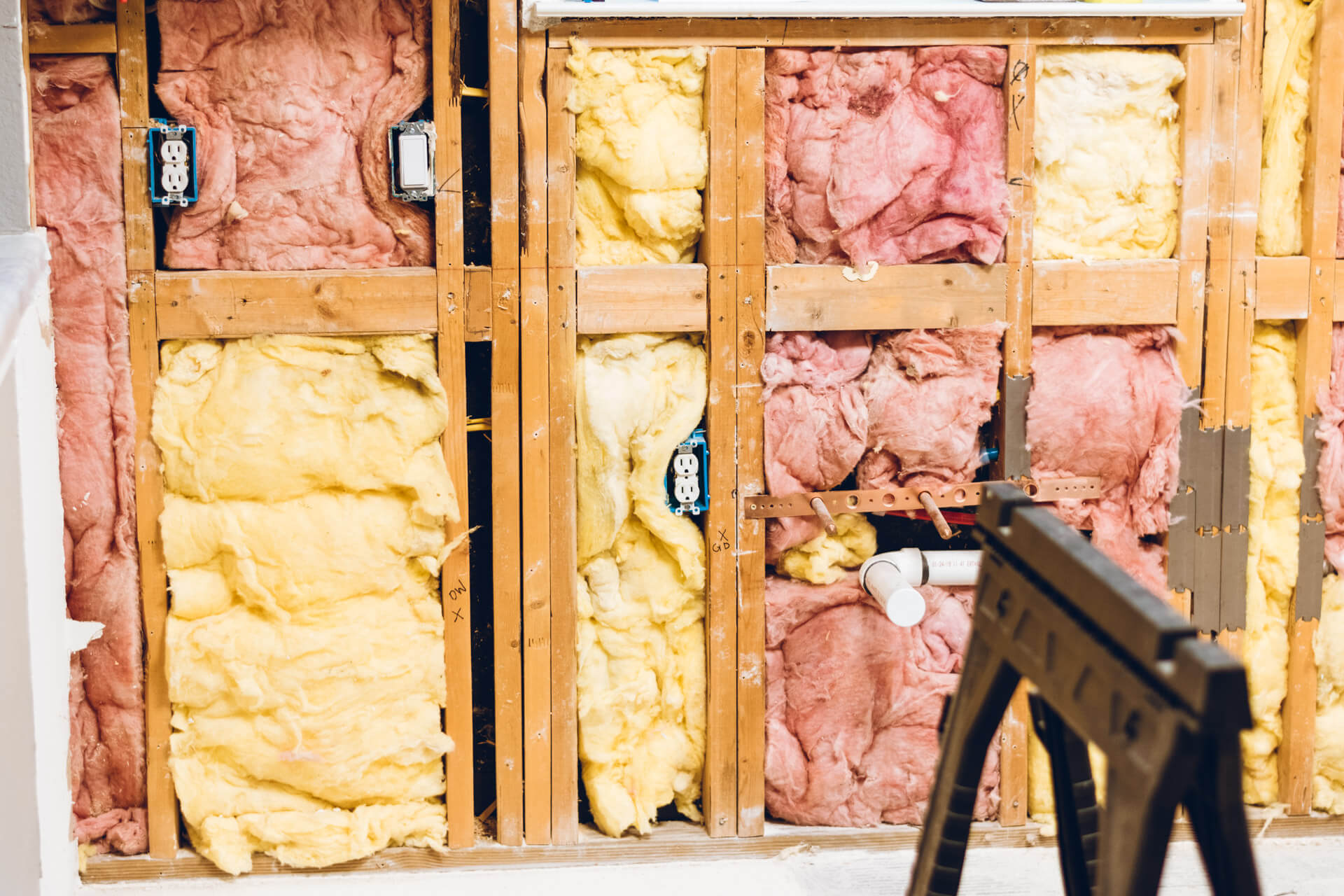 Wall with framing and insulation exposed